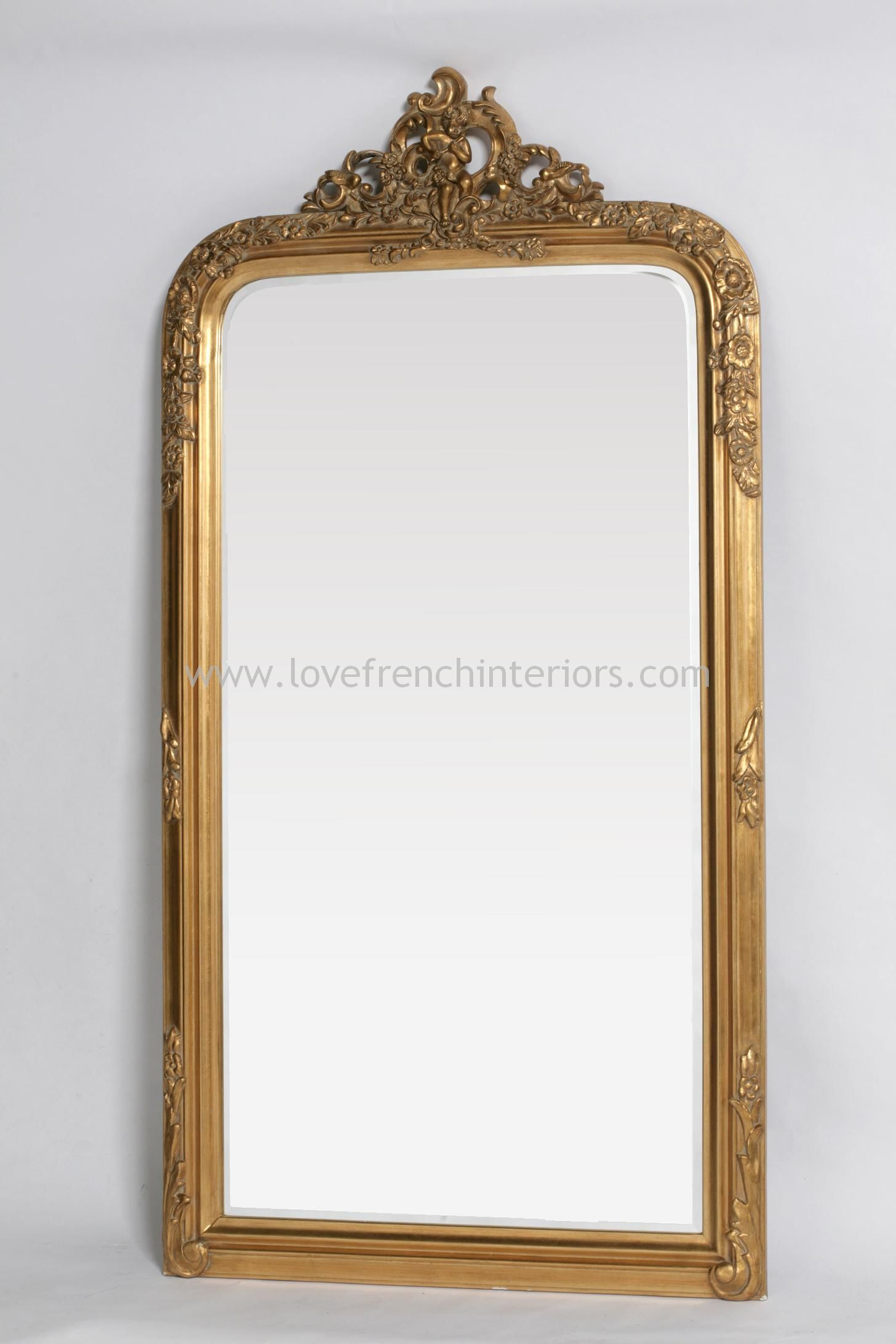 antique gold floor standing mirror with crest